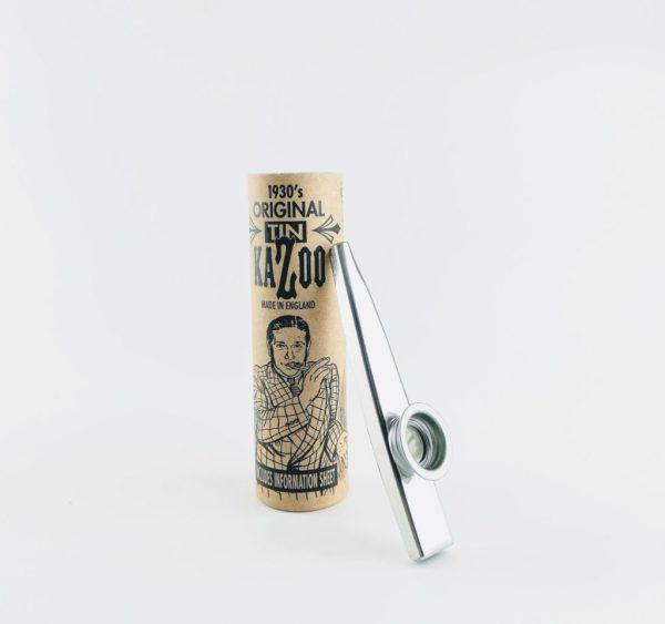 Clarke Silver Kazoo leaning against brown packaging