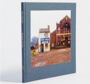 strangely familiar by peter mitchel with image of old newsagent on cover