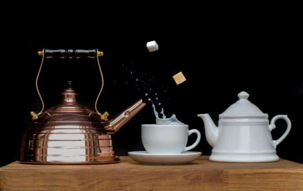 copper kettle with white cup and tea pot
