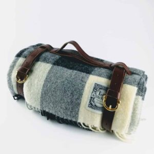 tolly mcrae black and white chunky picnic blanket, black and white check wool picnic rug, wool sofa throw with leather carry strap 1