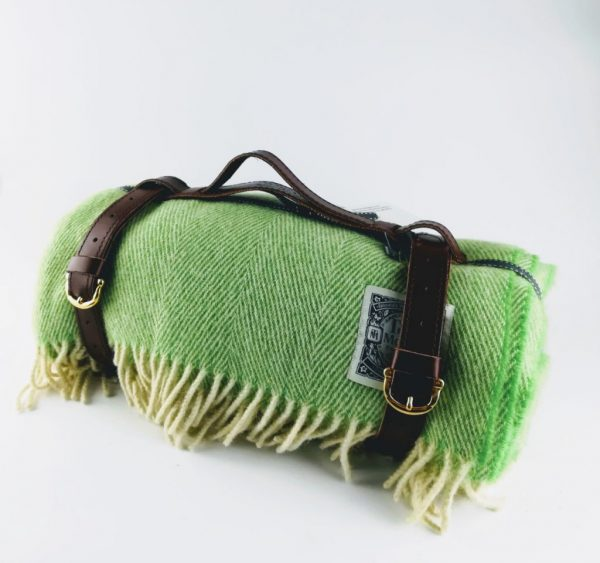 Tolly McRae gin and Tonic picnic blanket rolled up with leather carry strap