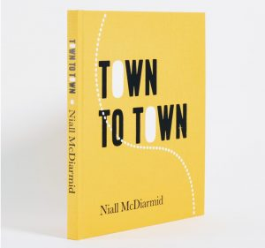 town to town coffee table book by Niall mcdiarmid with yellow cover