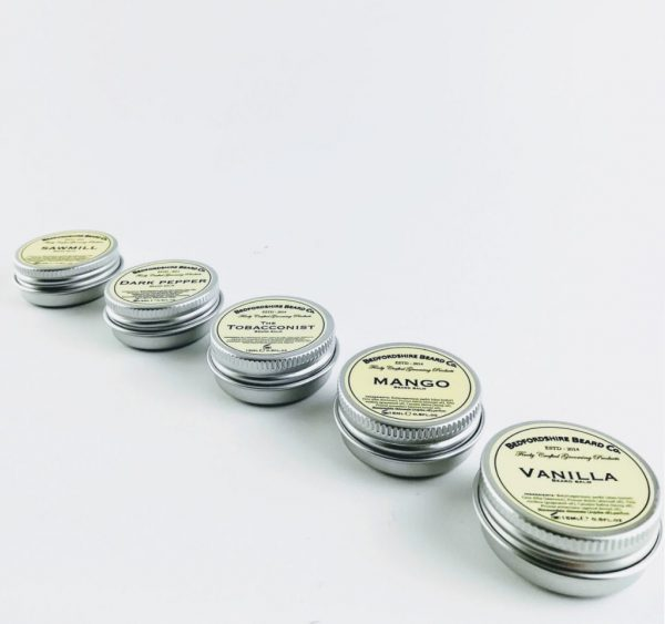 bedfordshire beard oil 5 tins of different scented beard balms in a row