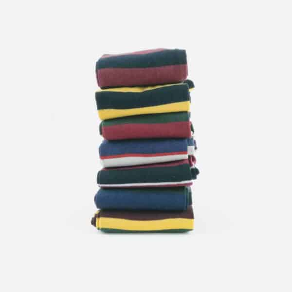 Regimental Sock Collection with 7 socks stacked on top of each other