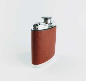 brown leather and pewter hip flask