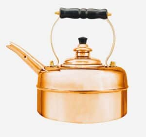 copper whistling kettle on white background
