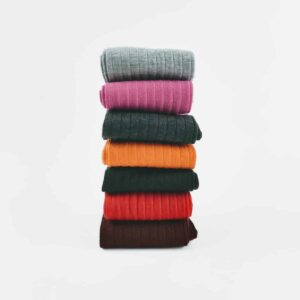grey, black, charcoal, pink, orange, red Corgi sock stacked on white background
