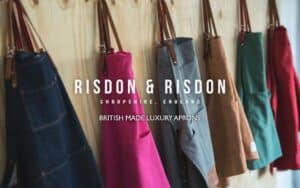 selection of coloured risdon and risdon aprons hanging on wall