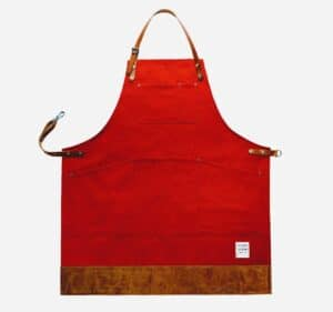 dark red canvas apron with leather trim