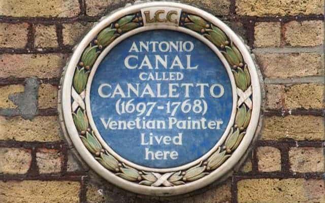 caneletto blue plaque on brick wall