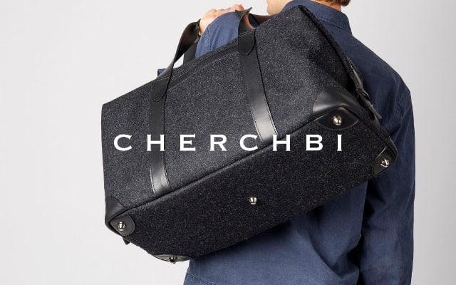 cherchbi brand lock up with man carrying a cherchbi black holdall