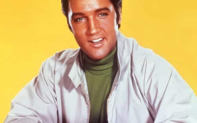Elvis Presley wearing a white baracuta G9 jacket on yellow background