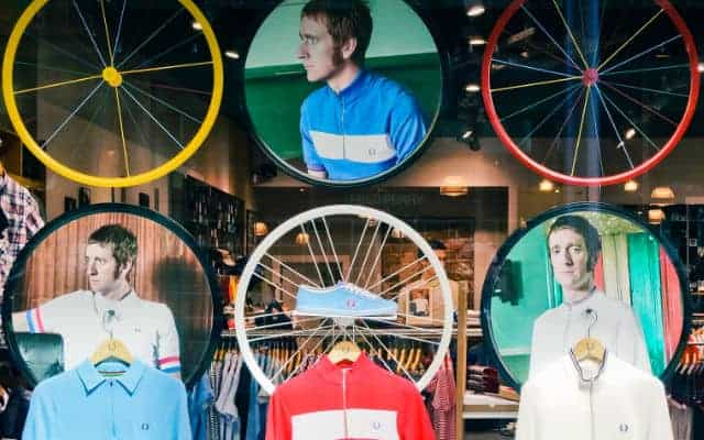 bradley wiggens wearing a fred perry and bicycle wheels