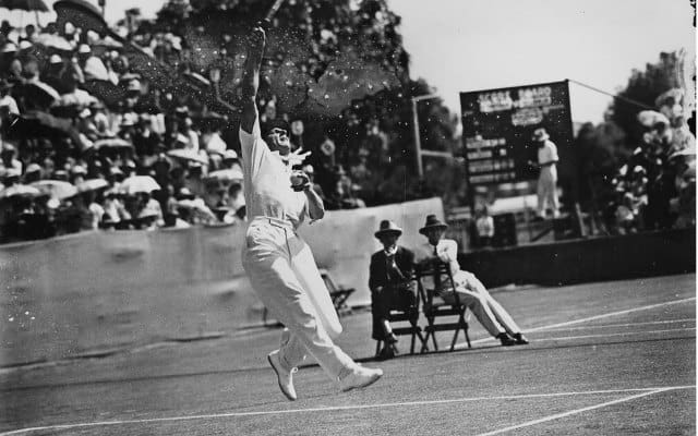 Fred Perry playing tennis