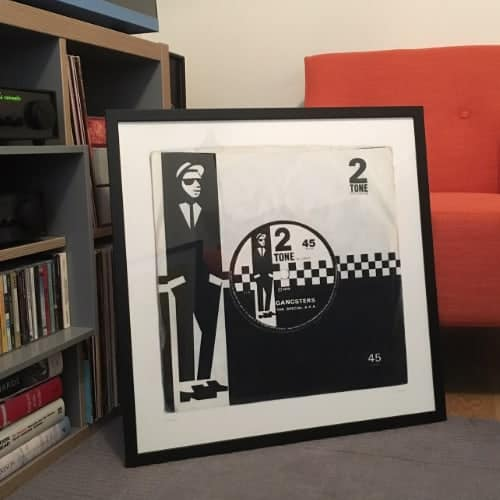 The Specials Gangsters giclee print in black frame sitting on floor