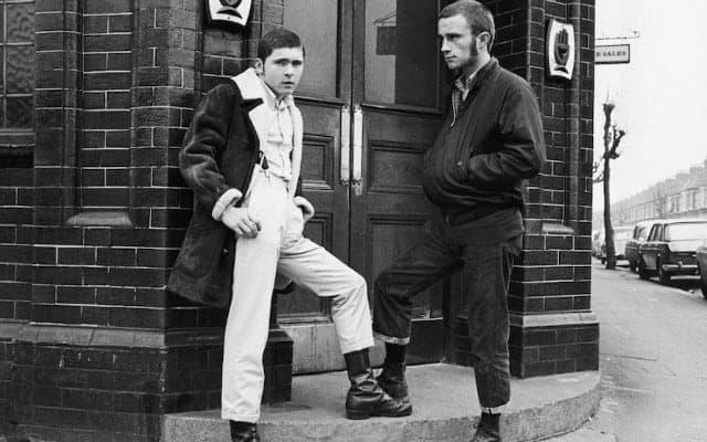 Skinheads outside a pub wearing a baracuta g9