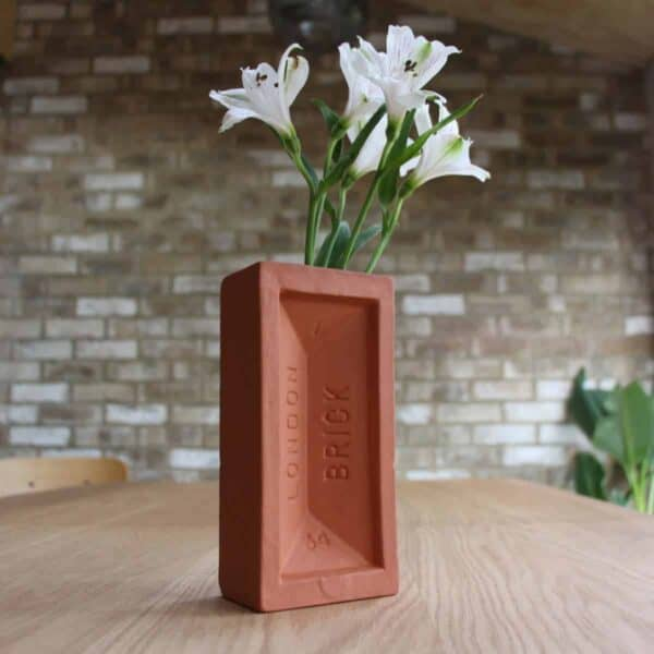 terracotta london brick vase on table with flower in it