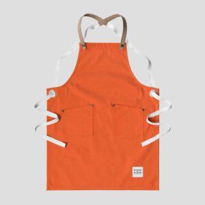 risdon and risdon childrens studio apron orange cork grey background