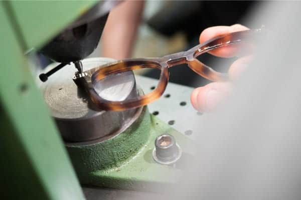 cglasses being riveted by riviting machine